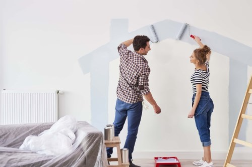 Couple painting house image